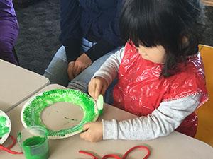Child making a decorative plate